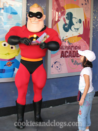 Mr. Incredible signing an autograph in Disney California Adventure Park near Disneyland