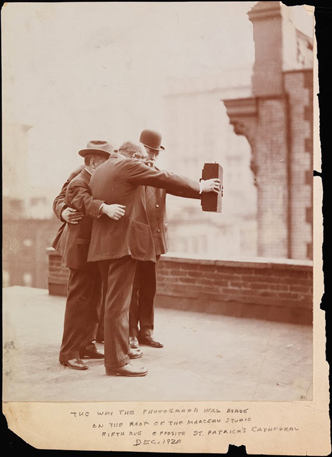 Historial photograph of men taking self photo ie selfie