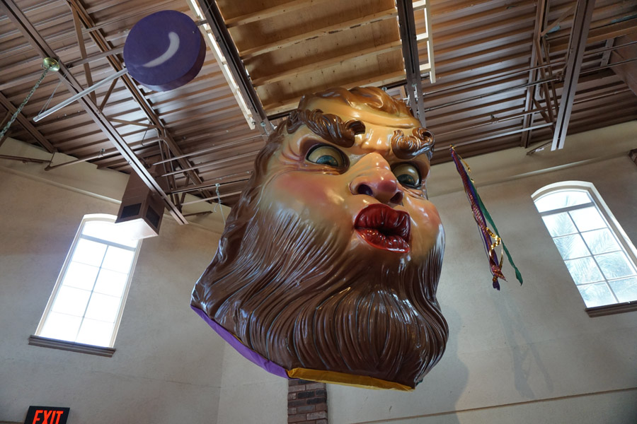 Cookies & Clogs | While traveling in the 2016 Kia Sedona, we visited the Sassagoula Floatworks and Food Factory for regular and gluten-free beignets. The massive Mardi Gras masks were creepy though.