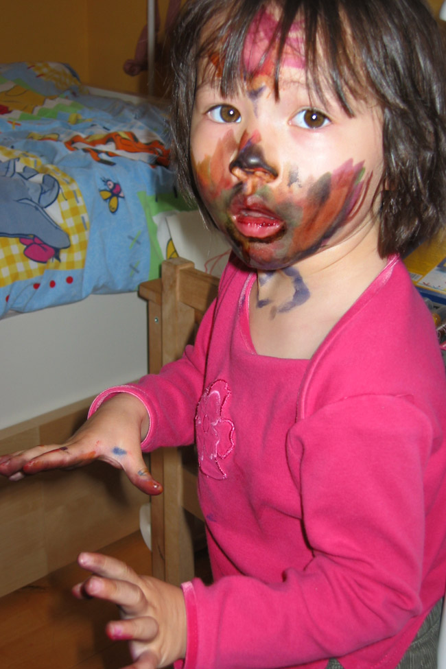 Cookies & Clogs | Everything changes when you have kids. Parenthood makes you do and say things you never thought you'd do when raising children. See how our parenting experience has gone and what two things have helped with cleaning up their messes. Female child with marker on face and hands.