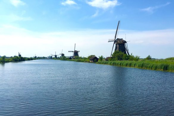 Cookies & Clogs | When visiting the Netherlands aka Holland, traditional Dutch windmills are a must-see. Kinderdijk is one of the best places to view these and with numerous photo opportunities. It is a UNESCO World Heritage site with 19 windmills.
