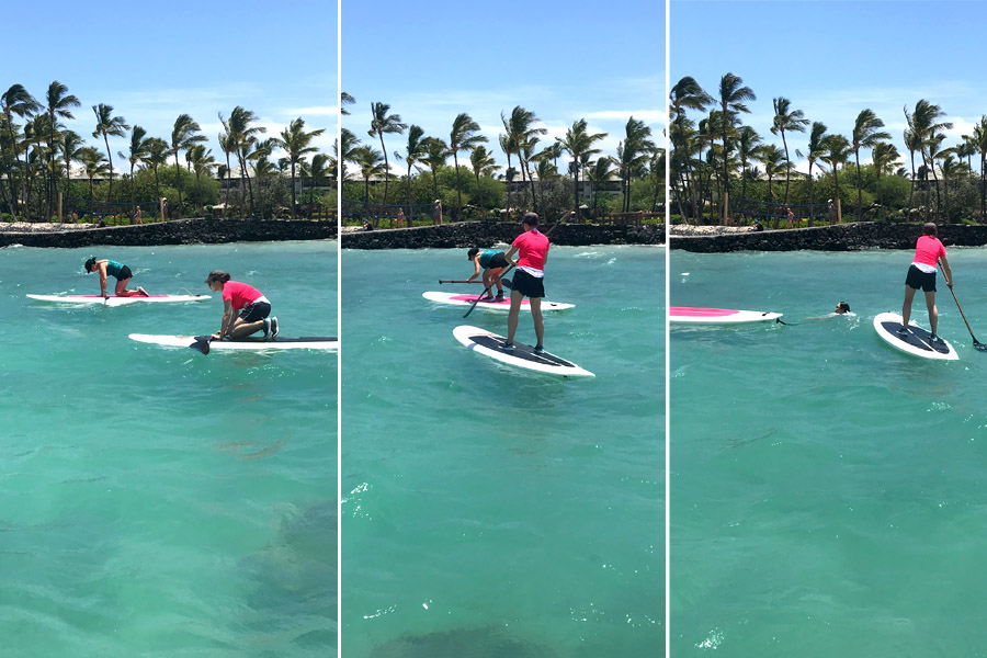 Cookies & Clogs | Oceans Sports Aloha Days offer 4 hours of unlimited water sports beach equipment including kayaks, stand-up paddleboards, snorkel gear, and rides on the glass bottom boat. One of the many things to do on the Big Island of Hawaii with kids. Falling off a paddleboard