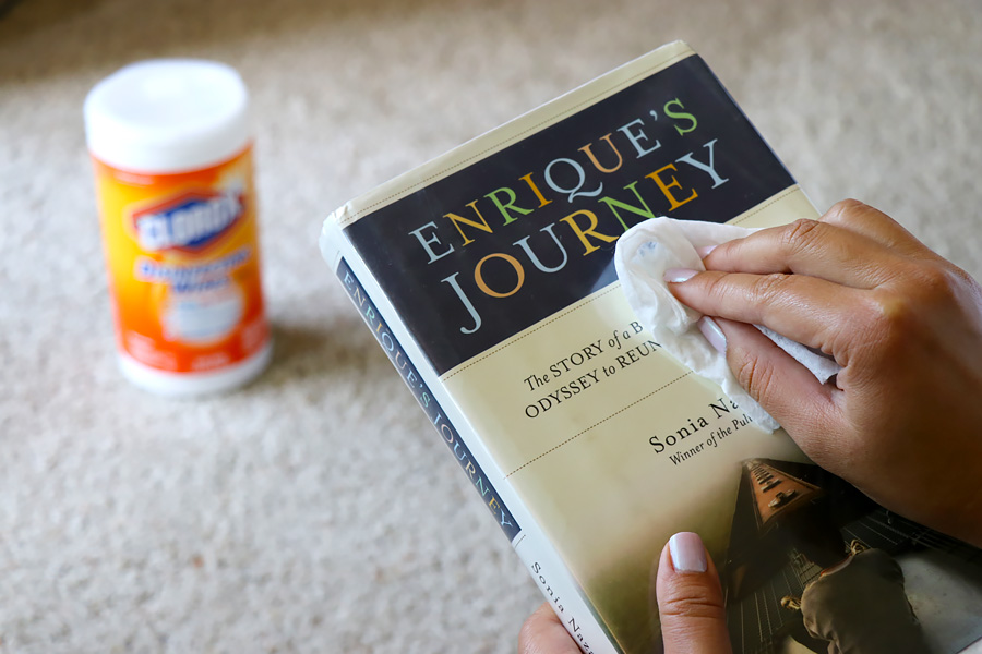 Getting ready for back to school shopping and using Clorox Disinfecting Wipes to disinfect library book covers.