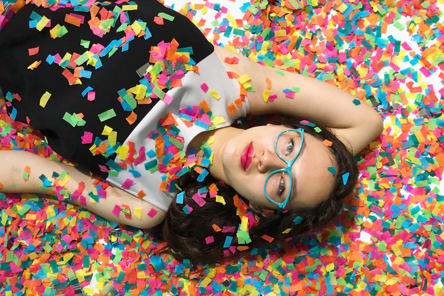 Color Factory in San Francisco, CA. Teen girl with confetti.