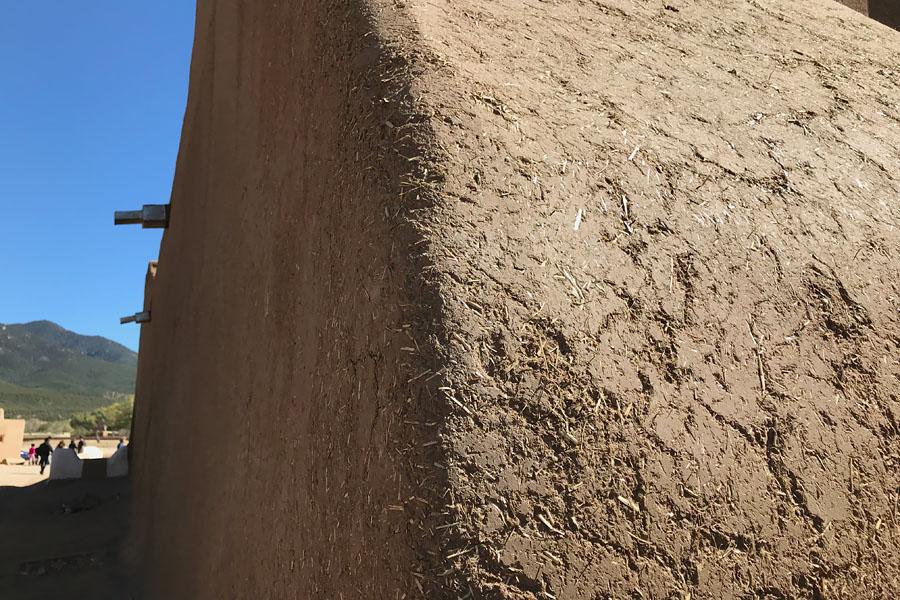 Taos Pueblo New Mexico Road Trip Travel Tips adobe pueblo with mud and straw