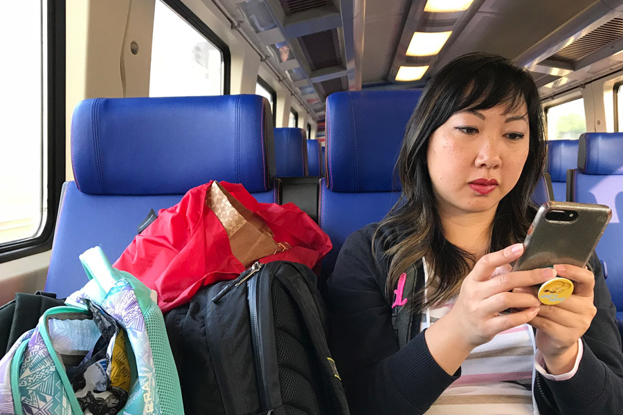 Reasonable and Reliable Cell Phone Service in Europe and other countries with Verizon TravelPass - Woman on phone on Train from Amsterdam, Holland