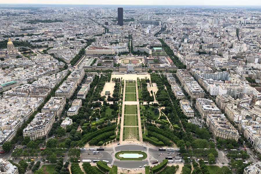 Paris Travel Guide: Top tips for how to visit the top of the Eiffel Tower in Paris France Paris overview of Champ de Mars and Montparnasse Tower