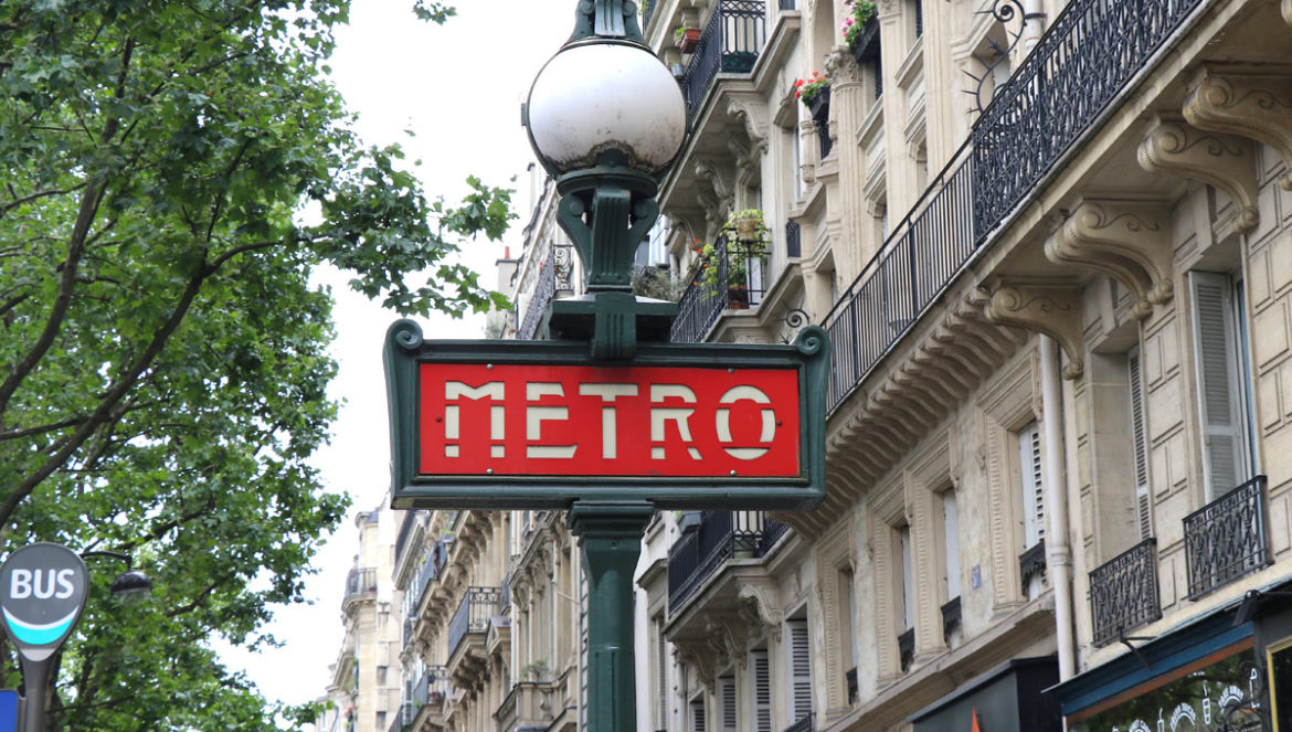 Paris Travel Guide: How to use Paris Metro & bus public transportation in Paris France w/ photos and video tutorial of how to buy tickets. Bus and red metro sign.
