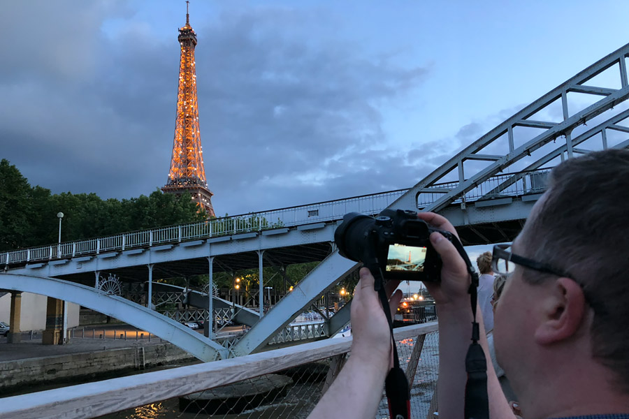 Best Paris boat tour tips for sightseeing cruise on the Seine River in Paris, France. Taking photo of Eiffel Tower