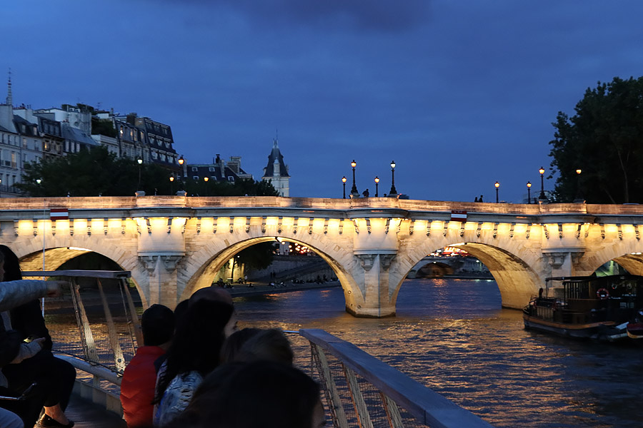 Best Paris boat tour tips for sightseeing cruise on the seine in Paris, France. Bridge at night
