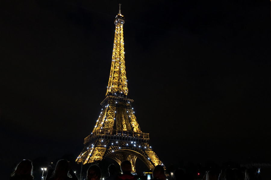 Best Paris boat tour tips for sightseeing cruise on the seine in Paris, France. Eiffel Tower at night sparkling