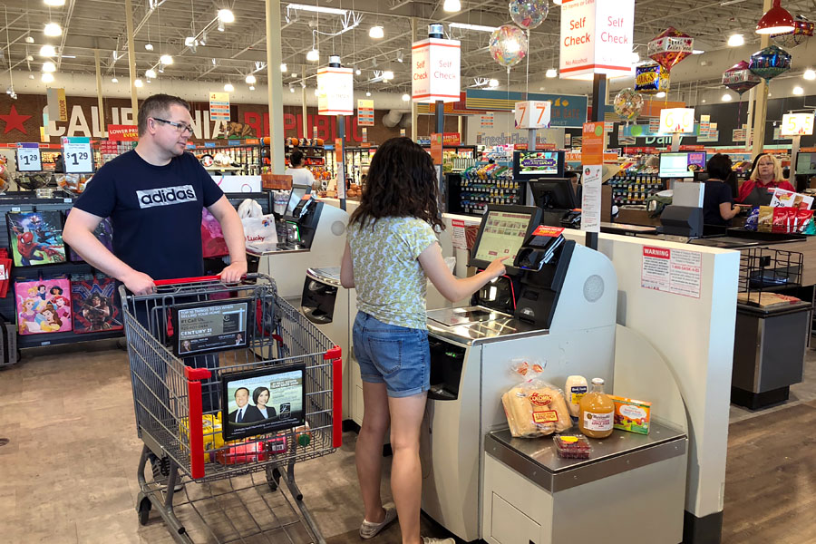 Back to School Grocery List and School Lunch Ideas. Teen shopping at Lucky Supermarket with optional ClickClick online grocery shopping and curbside delivery.